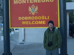 Welcome to Montenegro signpost at the port