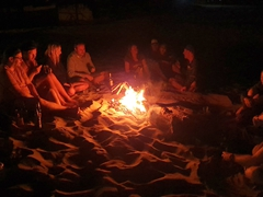 Hanging out by the bonfire at night; Punta Sal