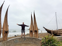 Robby posing with traditional reed boats; Trujillo