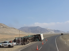 An overturned tractor trailer on a highway in Peru