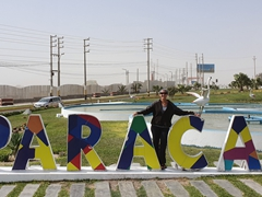 Posing by the Paracas sign - gateway to the Ballestas (Peru's version of the Galapagos)