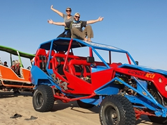 Posing on top of our dune buggy