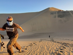 Robby after sand boarding down a steep sand dune; Huacachina