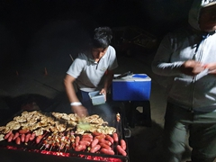 Desert Nights Ecocamp staff putting on a fabulous BBQ dinner for us in the middle of our desert camp; Huacachina