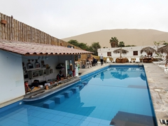 Breakfast by the pool at Desert Nights Ecocamp; Huacachina