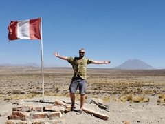 Robby posing by the Peruvian flag with Misti volcano in the background