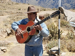 A blind musician sings us a song at Colca Canyon