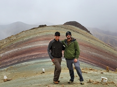 Posing at Palcoyo rainbow mountain