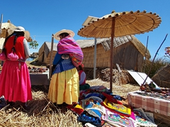 Uros ladies preparing to sell their wares; Lake Titicaca