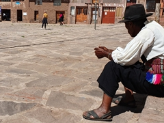 A senior council member overlooks the main plaza; Taquile