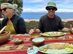 Robby enjoying our fresh trout for lunch; Taquile Island on Lake Titicaca