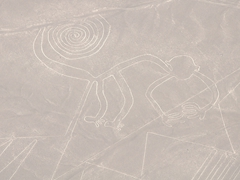 Nazca monkey with nine fingers and a spiral shaped tail
