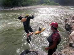 Jumping into the Urubamba River
