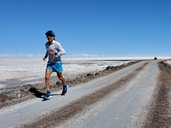 Athlete competing in an 80 km high altitude race across the Uyuni Salt flats