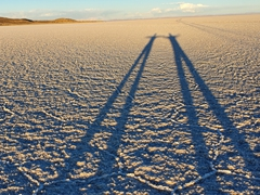 Our long shadows as the sun sets on Uyuni Salt Flats
