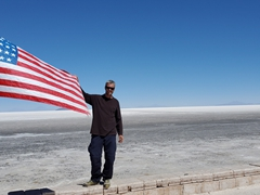 Robby with the USA flag; Uyuni Salt Flats