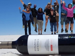 Standing on top of a wine bottle with our friends