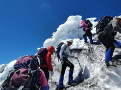 Geared with ice picks and crampons to hike Villarrica Volcano