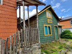 Quaint wooden shacks; Futaleufú