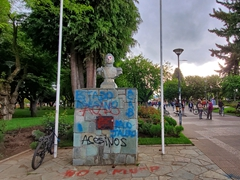 Protestors paint over the statue of Bernardo O'Higgins, a Chilean Independence hero; Coyhaique Plaza de Armas