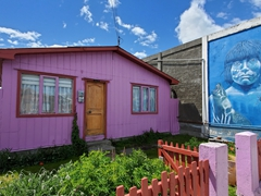 Colorful house and mural; Puerto Natales