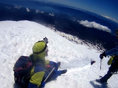 The fun part of the day is about to begin! Robby getting instruction for sliding down Villarrica volcano on his butt