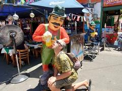 Robby chugging beer; Caminito