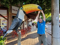 Robby next to a massive toucan statue; Bonito
