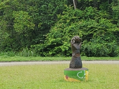 Fist statue at the roundabout leading to the Guiana Space Centre; Kourou