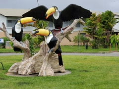 Massive toucans on display at a roundabout in Kourou