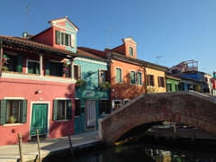 "Check out the ""Dr Jekyll and Mr Hyde"" house at the end of the bridge, half green and half red. Only in Burano!"