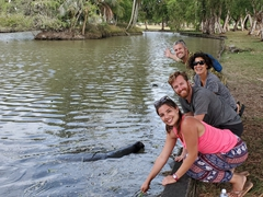 Posing with Rebeca and Jeremy next to the manatees of Georgetown