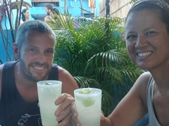 Enjoying free caipirinhas at Hostel Galeria 13, our home in Salvador