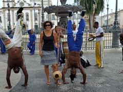 Capoeira (Afro-Brazilian martial art) dancers strike a pose; Terreiro de Jesus