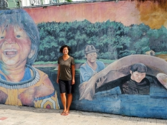 Becky posing next to street art; Manaus