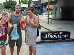 Cat, Robby and Amanda drinking caipirinhas to go while munching on Doritos - life is good in Leticia!