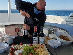 Martyn getting the beverages ready for wine & cheese time on the top deck