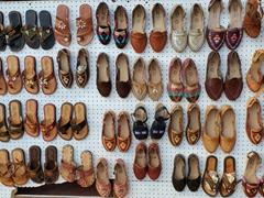 Leather shoes for sale at one of the souvenir shacks; La Bufadora