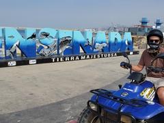 Posing at an Ensenada sign on our ATV