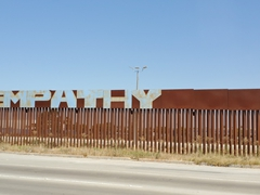 """""""Empathy"""" spray painted on the wall between Mexico and USA"""