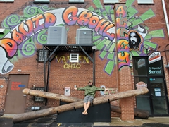 Robby sitting on top of the world's largest drum sticks at David Grohl (founder of Foo Fighters) Alley in Warren, Ohio