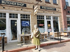 Life sized sculpture of a woman carrying groceries in Carmel, Indiana