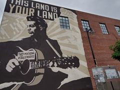"Mural of Woody Guthrie and his guitar displaying the label ""this machine kills fascists"" in Tulsa, Oklahoma"