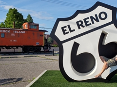 Robby chilling in an El Reno Rt 66 sign