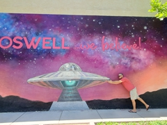 "Robby at a ""Roswell...we believe!"" mural"
