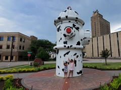 Emma and Grace at the world's largest working fire hydrant in Beaumont, Texas