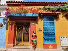 A colorful street scene with Becky trying to blend in!