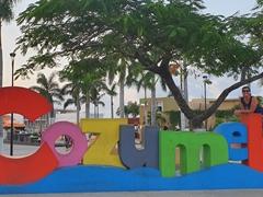 Becky at the Cozumel sign; Benito Juarez Park