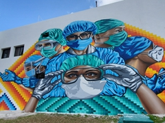 Massive mural paying tribute to doctors and nurses at the Palacio Municipal de Cozumel