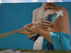 A massive mural of a man with a fish